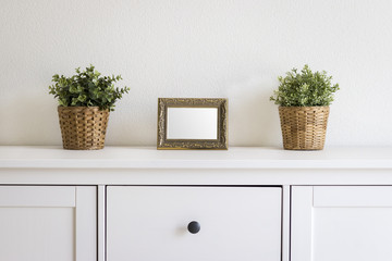 vintage photo frame mockup on white table desk with plants