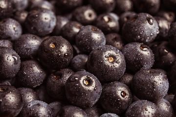 Fresh acai berries as background