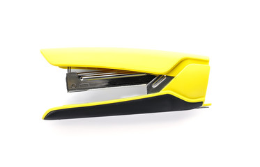 Yellow stapler on white background. Stationery for school