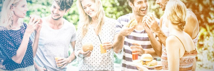 Group of friends having hamburgers and juice