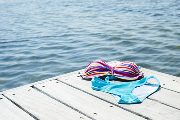 bikini drying on a wooden pier