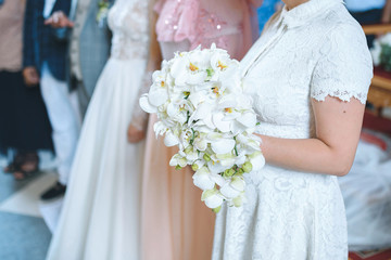 Bride with Orchid Bouquet