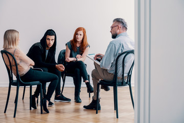 Teenagers on a group therapy with a psychiatrist