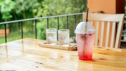 Mixed berry soda on a wooden table.