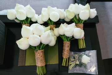 Beautiful bouquet with white roses and lotuses for the bride and bridesmaids