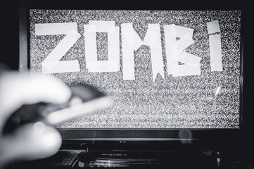 Man with a TV instead of a head. Media Zombie inscription. The multimedia Social networks concept