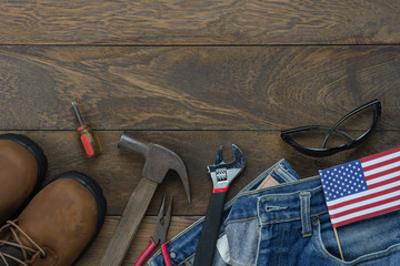 Table top view aerial image of decoration the sign of USA labor day on Sep 3,2018 background concept. Flat lay accessories tools and clothing  for worker on modern rustic brown wooden with copy space.