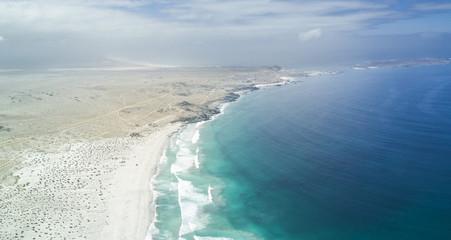 Punta de Choros at Atacama Desert amazing wild beaches. An aerial view of the Pacific Ocean crashing the land at Atacama sands, Chile