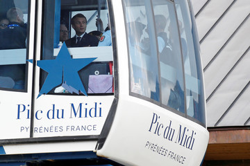 French President Emmanuel Macron is seen on a cable car after a visit at the Pic du Midi in the Pyrenees mountains at La Mongie in Bagneres-de-Bigorre