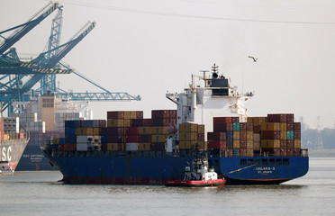 A container ship leaves the port of Antwerp