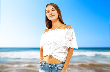 Slim young woman face and ocean landcape of blue color wiht sky.