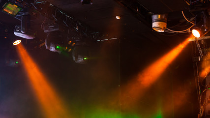 Scenic lights with strong beams in smoke