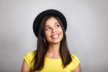 Positive human emotions. Close-up Portrait of happy brunette girl in hat smiling looking at camera