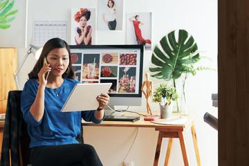 Graphic designer calling to client