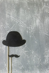 Paper accessories on a stick for a photo shoot on holidays or parties. Concrete background.