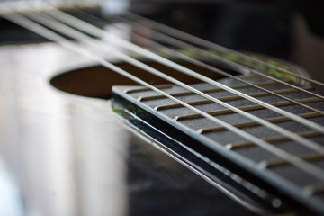 Detail of classic acoustic guitar with shallow DOF and blur.