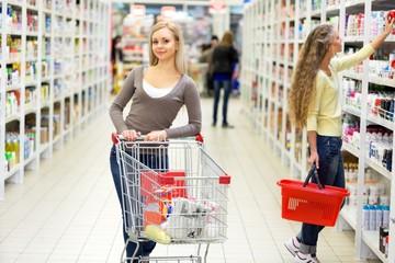 Portrait of Two Women Shopping in Supermarket