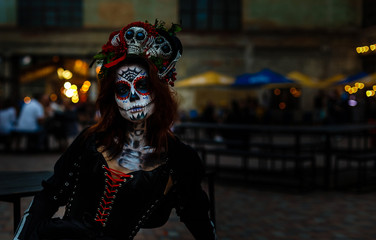 Attractive young woman with sugar skull makeup. Kiev, July 13, 2018