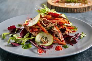 Spicy Salad with Beef, Greens, Pepper, Sesame, Garlic, Chili and Vegetables