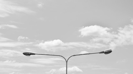 street lamp post with sky - monochrome