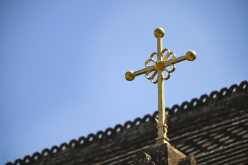 Religious cross on church roof