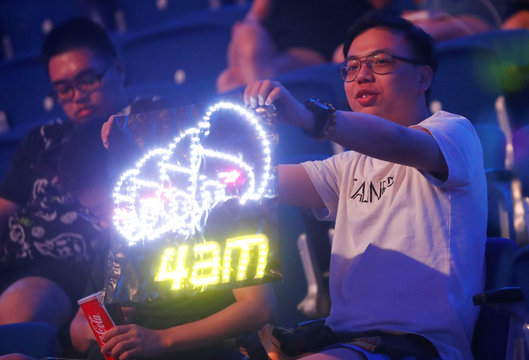 Supporters of the Chinese 'Four Angry Men' team react as they attend the PUBG Global Invitational 2018, the first official esports tournament for the computer game PlayerUnknown's Battlegrounds in Berlin