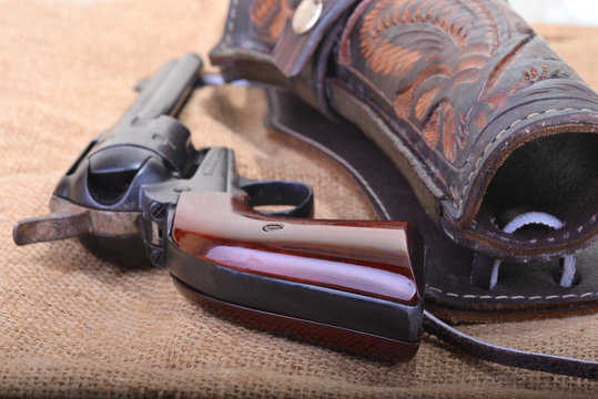 Close up of a western six shooter revolver with leather holster