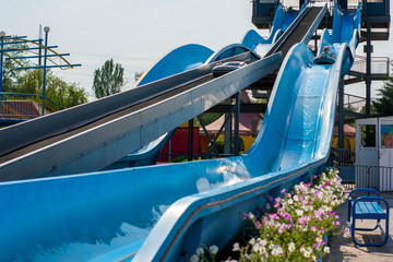 Water slides, attractions of blue color in the park.