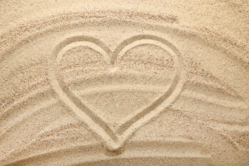 Heart drawn on beach sand