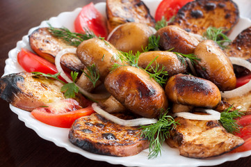 Fresh grilled vegetables in a white dish