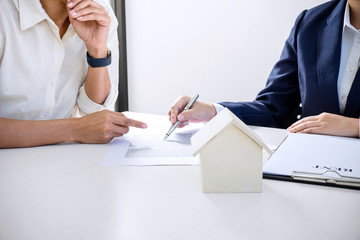 Real estate broker residential agent being analysis and making the decision a home estate loan to customer and waiting for reply to finish house and car rent listing contract
