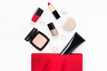 Wall Mural - Makeup cosmetic products for woman in gift red bag