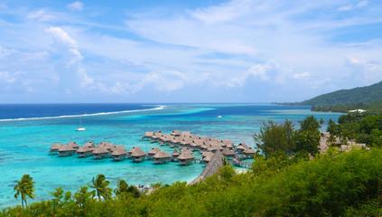 Foto op Canvas Oceanië Beautiful overwater villas in stunning lagoon overlooking tropical sunny island.