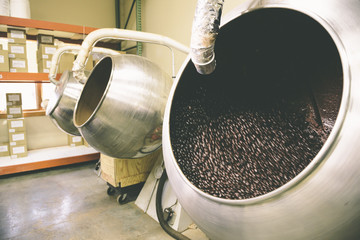 Coffee beans in vat at roasting factory