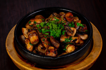 Roasted mushrooms in the pan