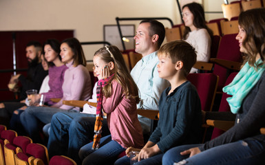 People enjoying funny film
