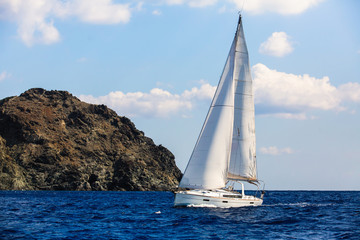 Sailing among Greek islands in Aegean Sea. Luxury yachting.