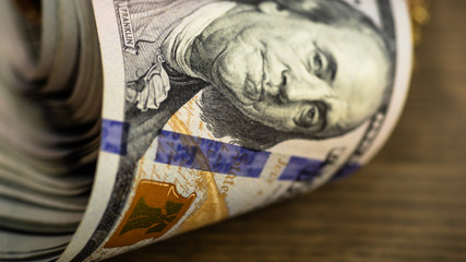Macro shot of a 100 dollar. Dollars Closeup Concept. American Dollars Cash Money. Hundred Bucks. Benjamin Franklin's portrait.