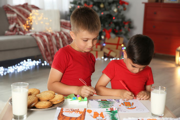 Little children drawing picture at home. Christmas celebration