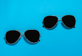 2 Sunglasses on a blue background