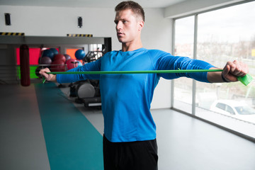 Man Warms Up With the Latex Resistance Band