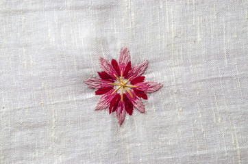 Embroidered satin seam, melange threads,red pink flower cornflower on coarse cotton fabric