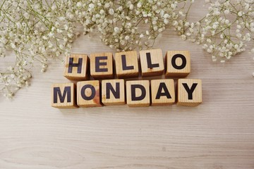 hello monday alphabet letters on wooden background