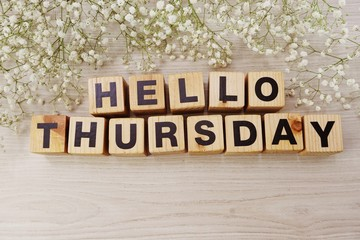hello thursday alphabet letters on wooden background