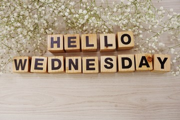 hello wednesday alphabet letters on wooden background