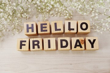 hello friday alphabet letters on wooden background