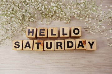 hello saturday alphabet letters on wooden background
