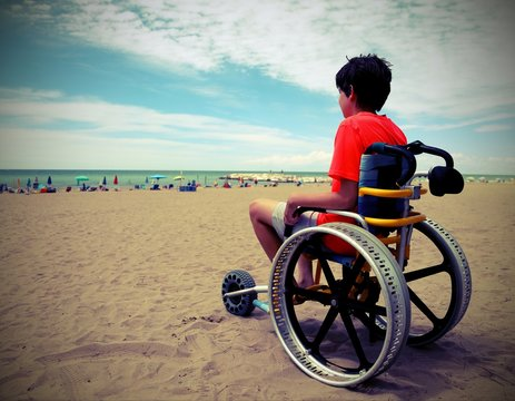 boy on the special wheelchair with aluminum alloy wheels with vi