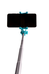 Monopod for selfie with smart phone. Selfie stick with smartphone isolated on white background