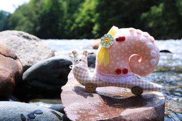 The image of the toy is a snail. Handmade.